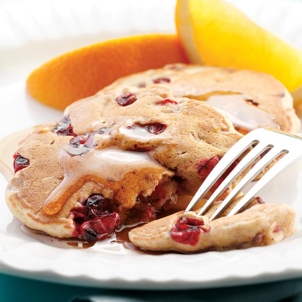 Start your day off right with these easy pancakes, packed with cranberry's sour spike. One of you can make the coffee and heat the maple syrup while the other makes the pancakes. It's instant relationship bliss. Source: EatingWell Magazine, November/December 2007