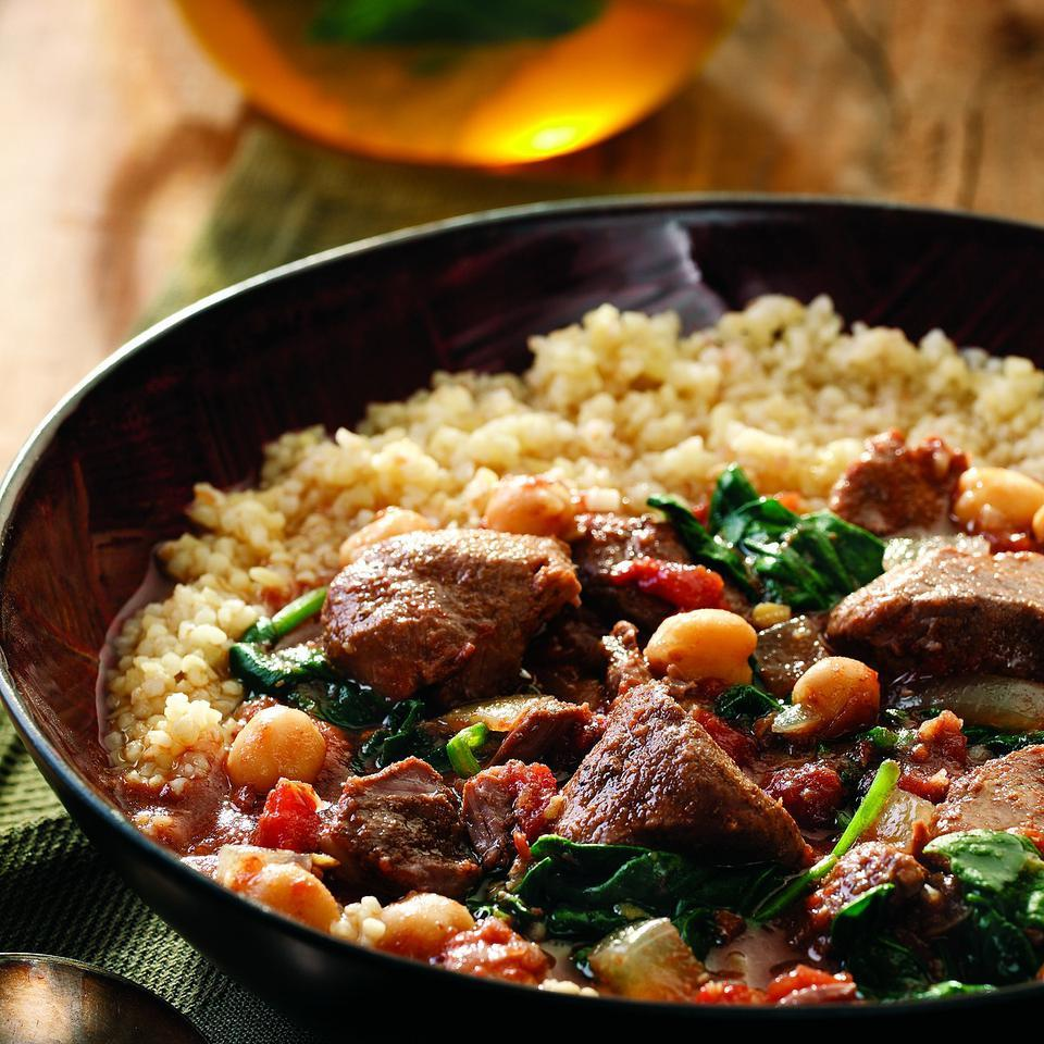 This brothy stew is boldly flavored with a blend of characteristic Middle Eastern spices and finished with fresh spinach and fiber-rich chickpeas. Economical lamb shoulder tenderizes beautifully when leisurely cooked in a slow cooker. If you can't find boneless shoulder stew meat, do not substitute more-expensive lamb leg--it tends to dry out during slow cooking. Instead, purchase lamb shoulder chops and debone them. Serve over bulgur and accompany with a salad.Source: EatingWell Magazine, January/February 2008