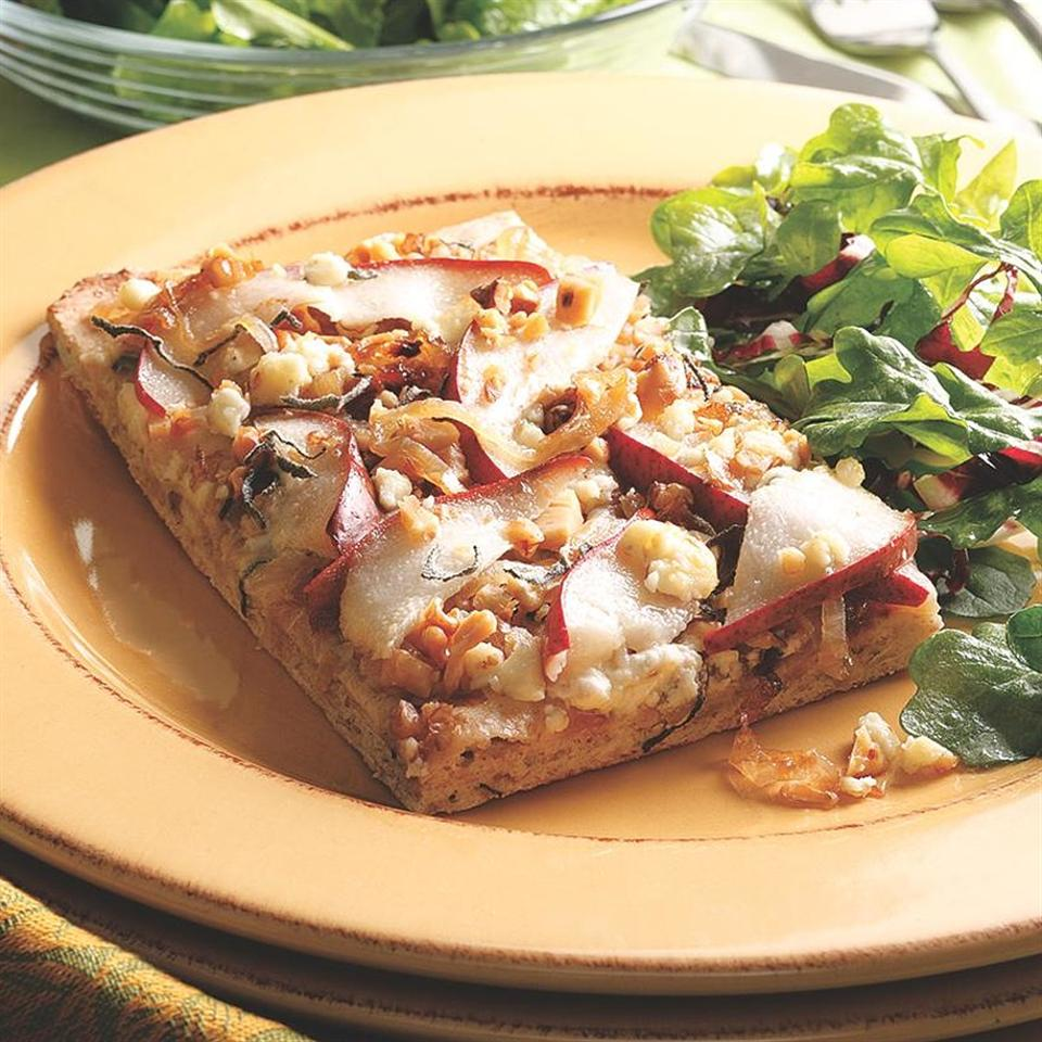 The classic combination of pears, walnuts and blue cheese isn't just for salad. Toss the same ingredients onto purchased whole-wheat pizza dough and make your own gourmet flatbread at home. Any type of ripe, firm pear will work--red pears look great.