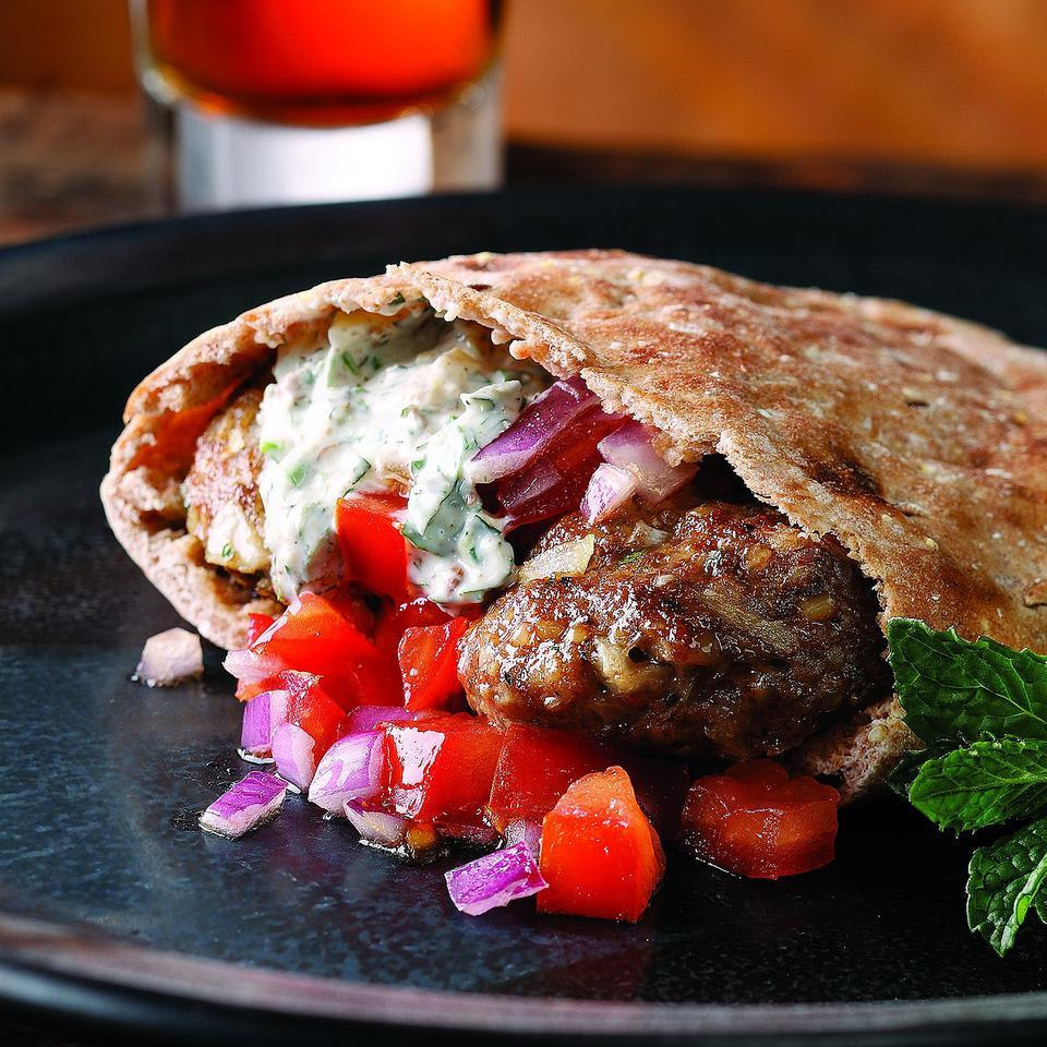 Heavy on exotic spices, this decadent sandwich is a great way to familiarize yourself with the joys of Turkish cooking. Lean turkey blended with lamb lightens the mix. Stuff the patties into warm pita bread or roll the mixture into meatballs and serve with the yogurt sauce on the side as an hors d'oeuvre.Source: EatingWell Magazine, May/June 2008