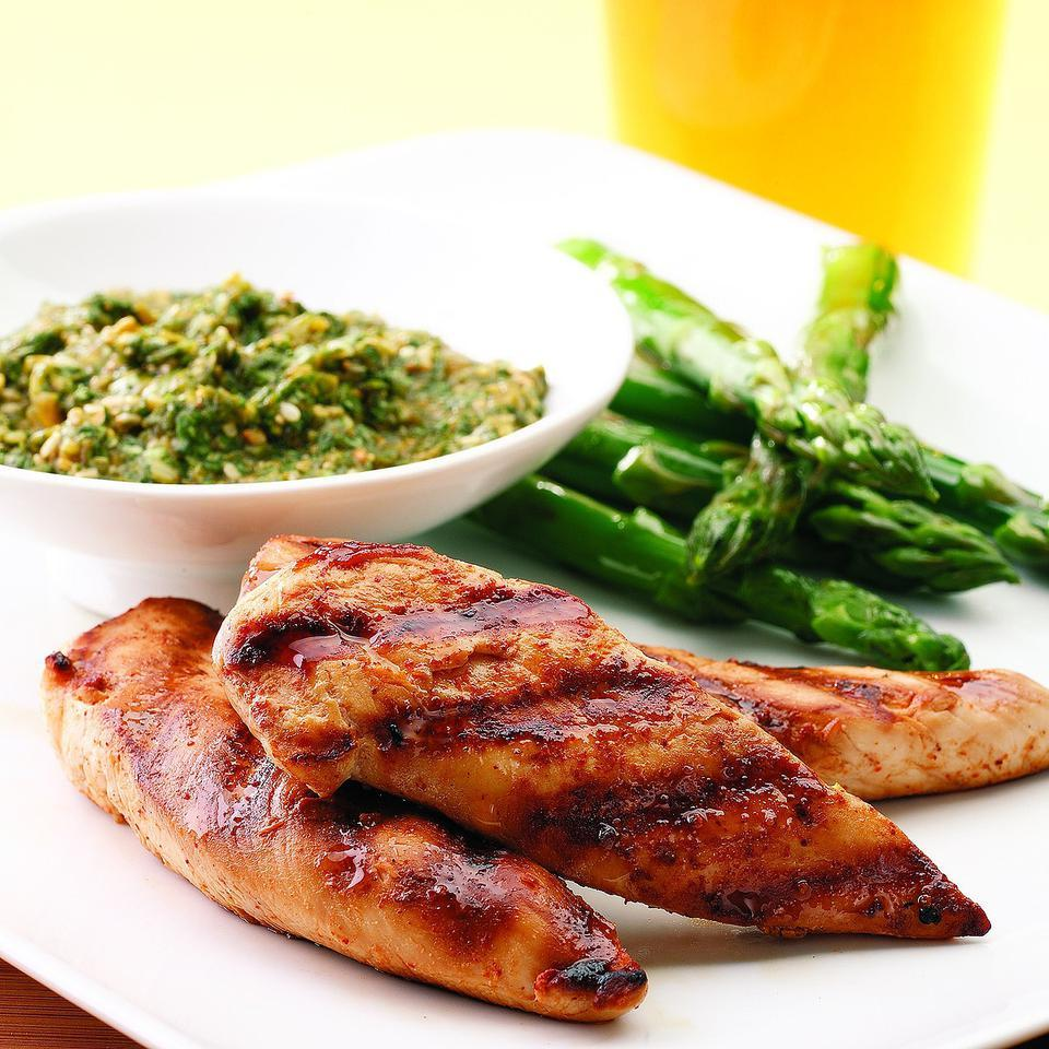 Cook chicken tenders quickly on the grill and top with pesto made with cilantro and sesame seeds for a zesty, speedy dinner. Serve with: Quinoa and grilled asparagus. Source: EatingWell Magazine, May/June 2008