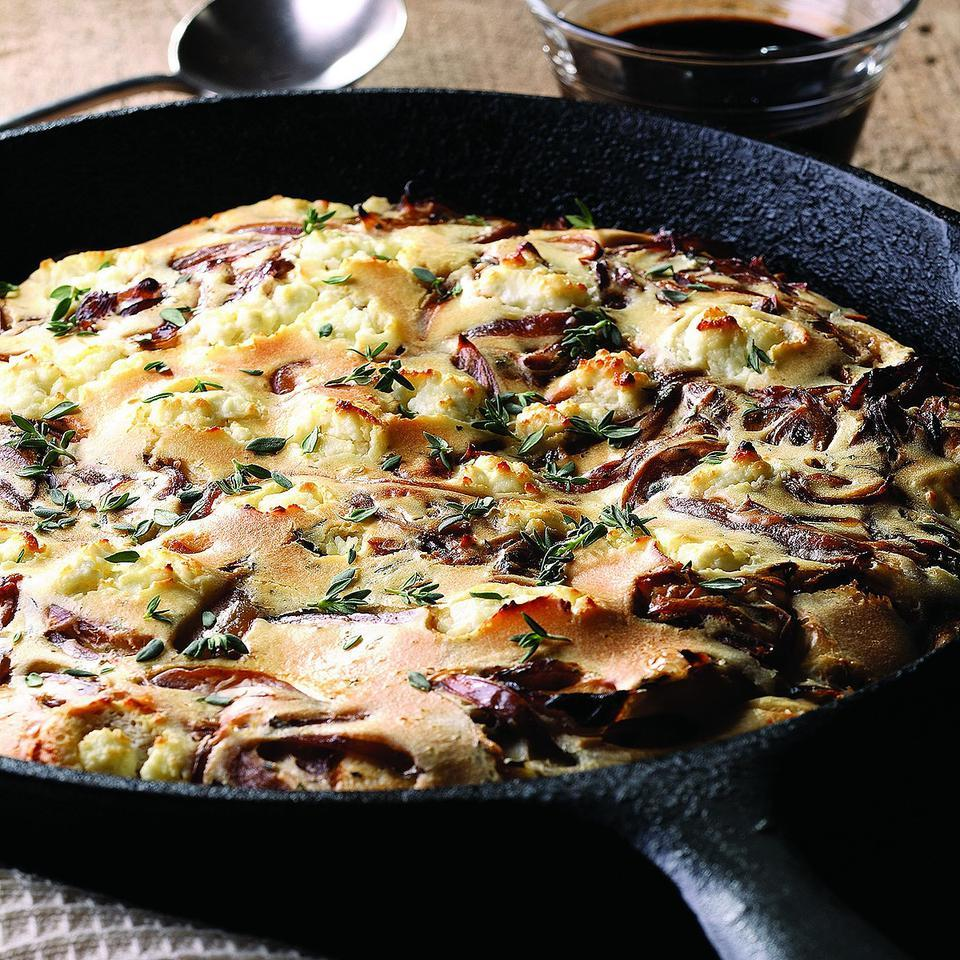 The technique for this pancake is similar to that for a Dutch baby or German pancake, but the savory onion and goat cheese combination is a surprise for those who think of pancakes as breakfast food only. Serve with a mixed green salad for a light supper or as a side dish with grilled or roasted meat. Source: EatingWell Magazine, May/June 2008