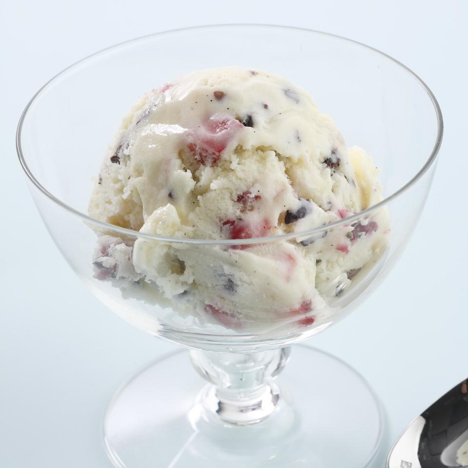 Chopped strawberries and cocoa nibs are a colorful addition to vanilla ice cream.