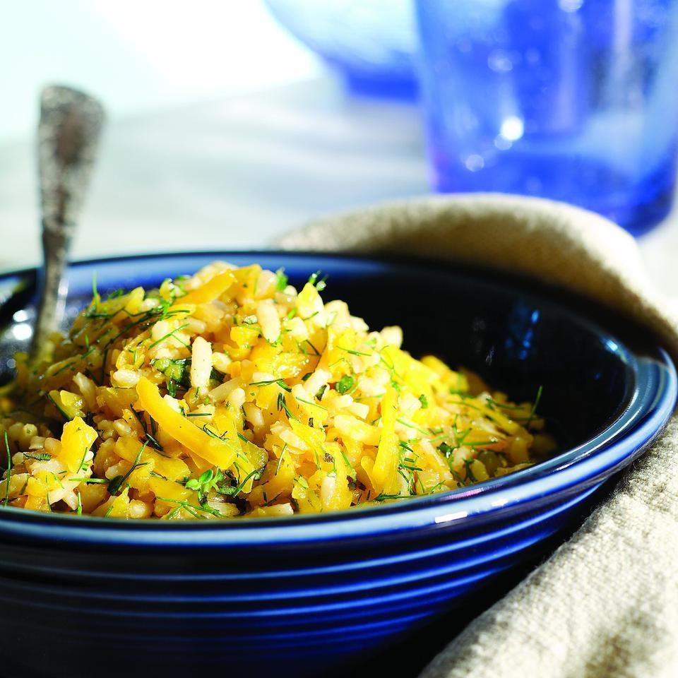 Grated butternut squash adds color and nutrients to this brown rice pilaf. This is a riff on a traditional Greek dish that calls for Greek pilaf rice and pumpkin; here we've substituted instant brown rice and butternut squash.