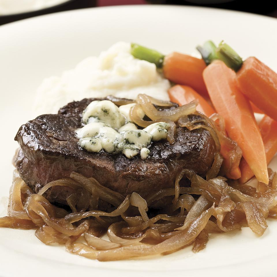 In our humble opinion, steak is best topped with sweet caramelized onions and salty Gorgonzola cheese. We recommend seeking out good-quality Gorgonzola for the best flavor, but any will work. Serve with garlic mashed potatoes and steamed carrots.