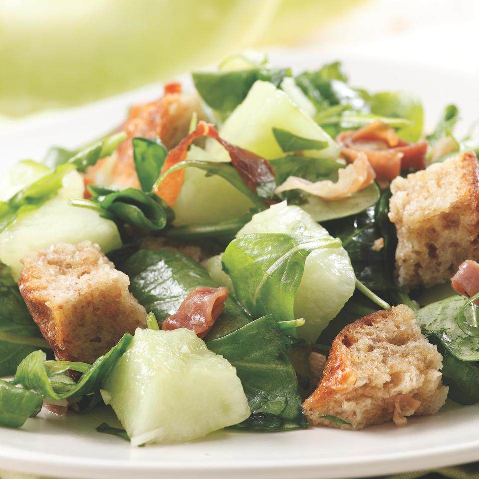 Traditional panzanella, Italian bread salad, was the inspiration for this dish. This variation uses sweet, ripe melon instead of tomatoes, plus peppery arugula and a touch of sizzled prosciutto to complement the taste of the melon. Try firm-textured orange- or green-fleshed melons, such as honeydew, casaba, cantaloupe or Galia. We even like it with watermelon.