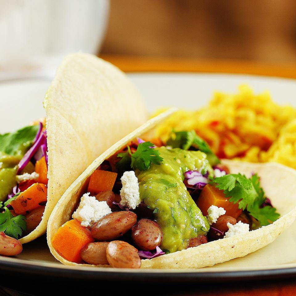 Beans and roasted butternut squash make an outstanding vegetarian taco filling. For the best flavor, use fresh, good-quality chili powder and Mexican oregano. Look for both at Latin markets or in the bulk spice section at well-stocked natural-foods stores.