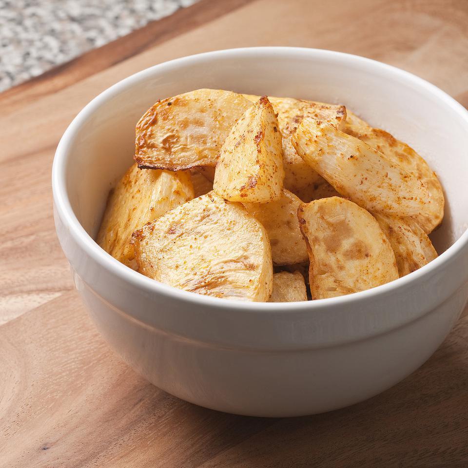 Roasted potatoes get a spicy, smoky flavor when tossed with ground chipotle pepper. If you like potato skins, just scrub the potatoes and leave the skins on--they add fiber and great texture.