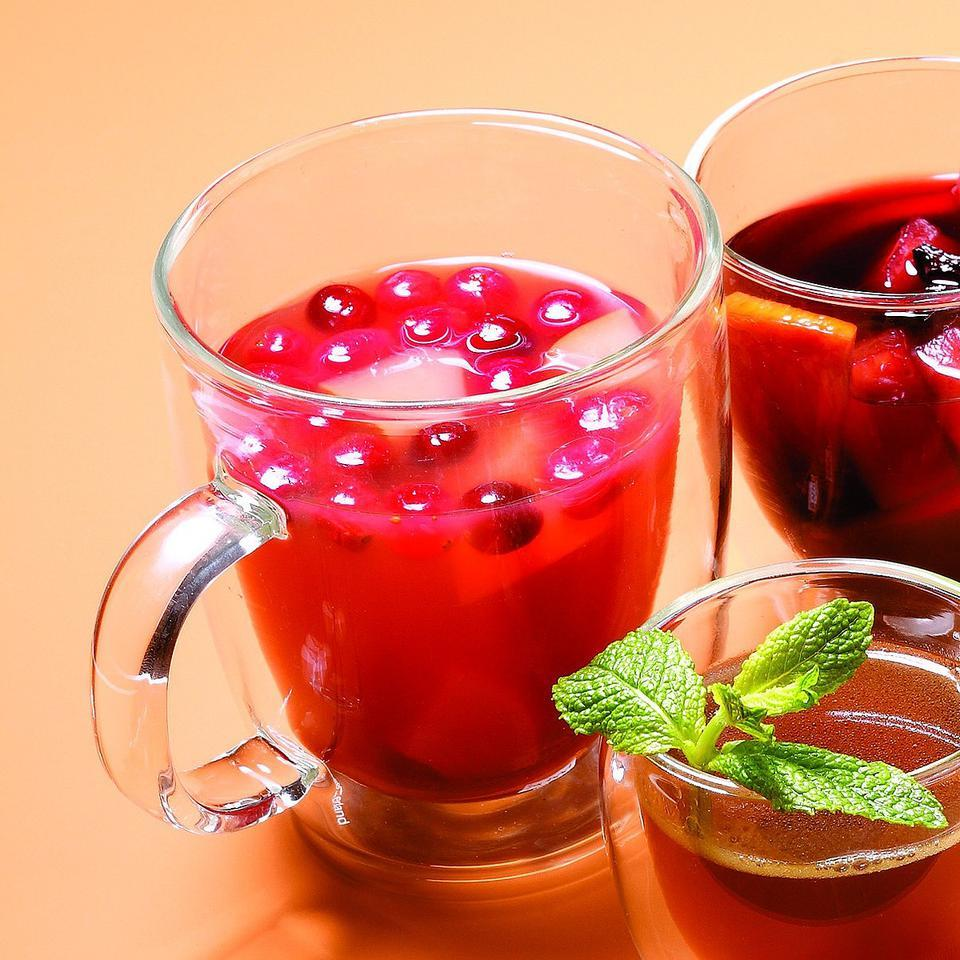 This scrumptious nonalcoholic punch adds pear, cranberries and vanilla to the traditional hot cider.