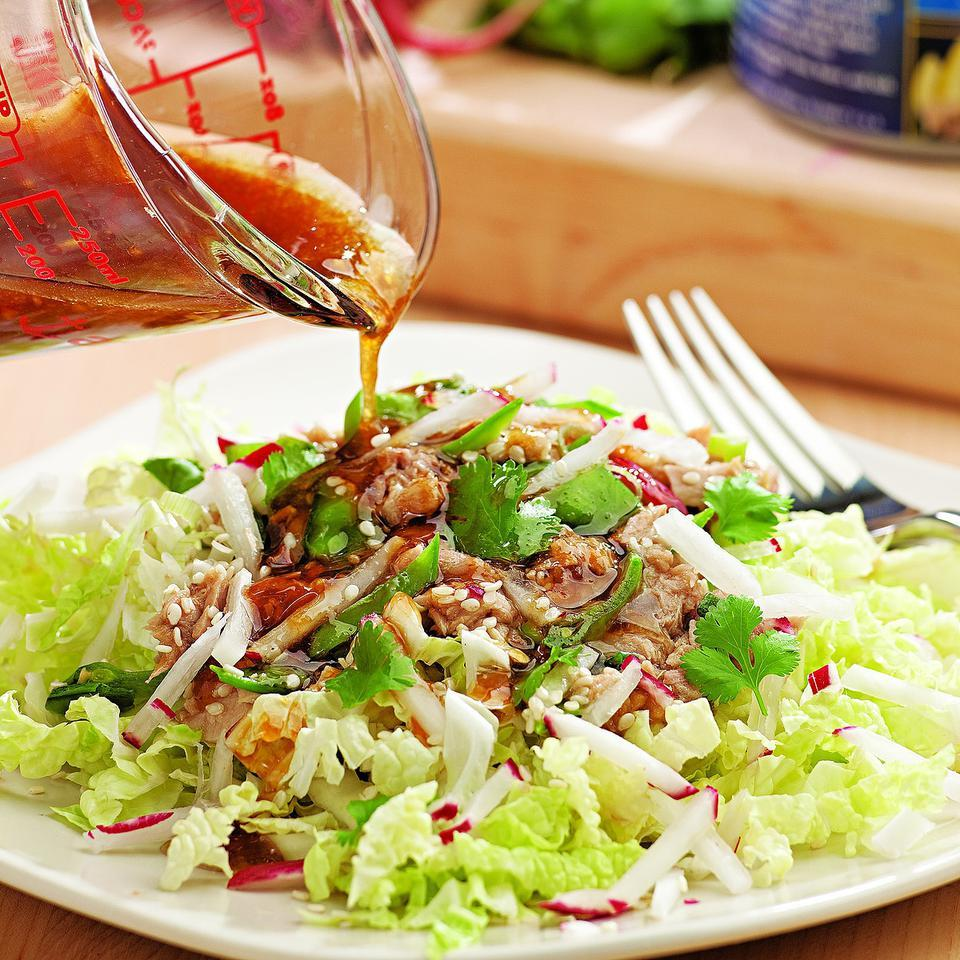 Toasted sesame oil transforms a humble staple like canned tuna into an elegant supper. We love the crunch of napa cabbage in this salad, but romaine lettuce would also work if you happen to have that on hand. Source: EatingWell Magazine, September/October 2010