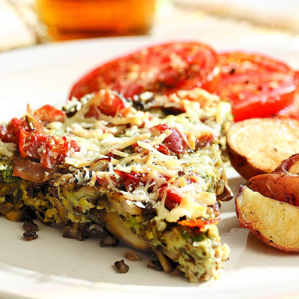 Packed with a flavorful medley of chewy wild rice and three kinds of mushrooms, this satisfying frittata is perfect for Sunday brunch. Don't worry if you can only find one kind of mushroom--the richly aromatic top of baked Parmesan and crisp prosciutto will make up for it.