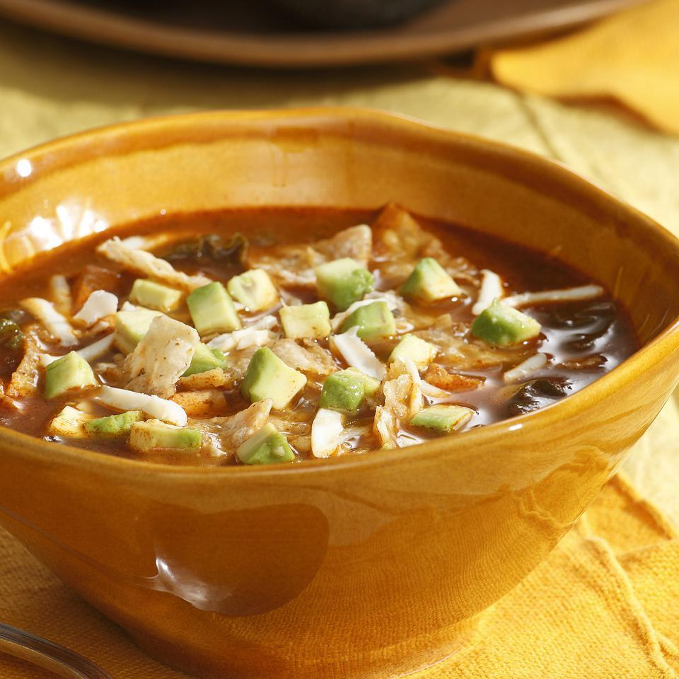 """Tortilla soup has a place, I feel, in practically every collection of Mexican recipes,"" says Rick Bayless. This is a vegetarian version of the classic soup, usually made with chicken. Earthy dark pasilla chile flavors the soul-satisfying broth. (Recipe adapted from Rick Bayless.) Source: EatingWell Soups Special Issue April 2016"