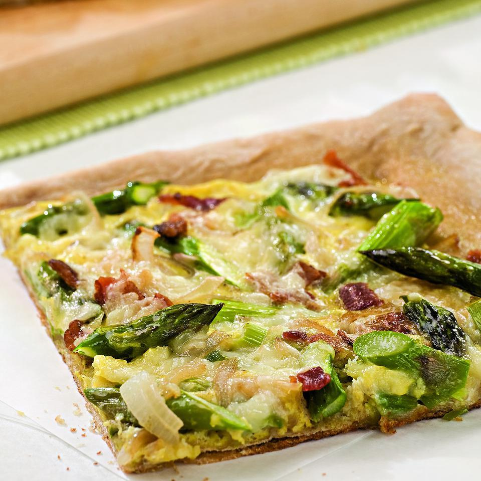 This pizza, topped with bacon, eggs and asparagus, was inspired by a wood-fired-oven pizza served at the Montpelier, Vermont, farmers' market. Serve with: Mixed green salad. Source: EatingWell Magazine, March/April 2010
