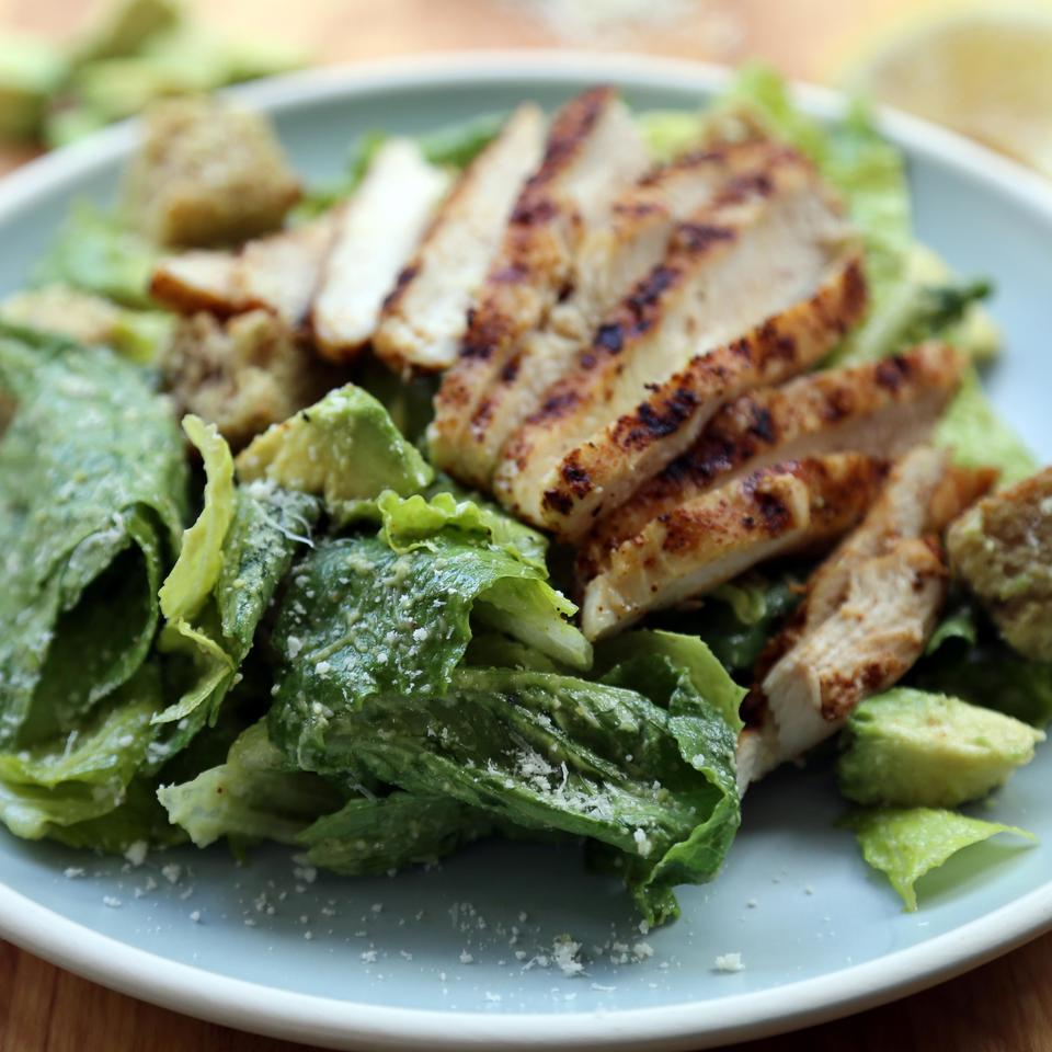In this Southwestern spin on the classic Caesar salad, avocado stands in for raw egg and some of the oil in this rich, creamy dressing. Grilled spice-rubbed chicken makes it satisfying.
