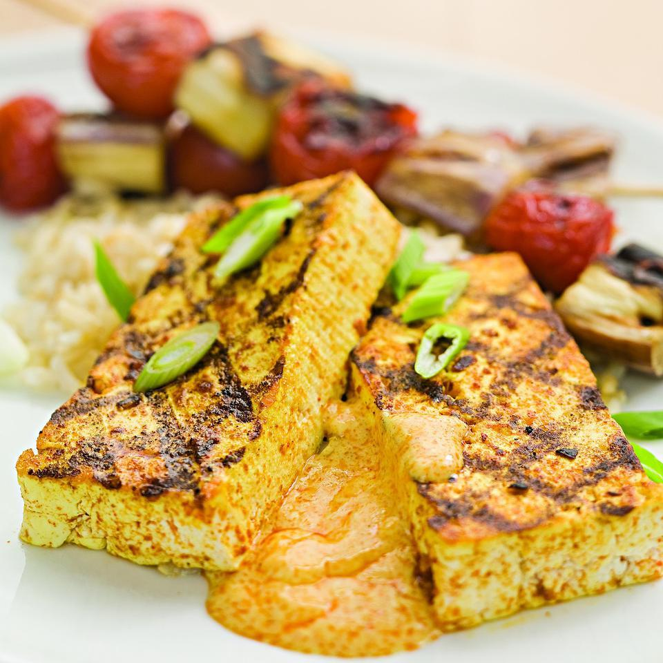 "A tandoori-inspired spice rub and smokiness from the grill flavor these tofu ""steaks."" While you're there, grill some vegetables, too, to serve alongside. Serve with: Grilled eggplant and cherry tomato skewers and brown basmati rice. Source: EatingWell Magazine, May/June 2010"