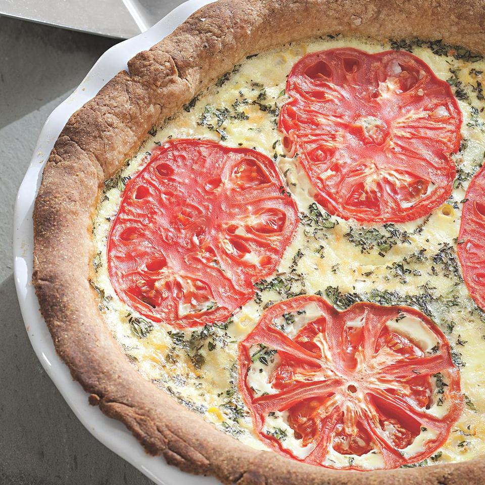 Tomatoes and corn have a natural affinity for one another: the slight acidity of tomatoes balances the sweetness of the corn. Here they partner in a delicious quiche-like pie. The dough is very forgiving and bakes up into a sturdy shell that's great for just about any savory pie or tart. Perfect for a summer brunch or try it with a tossed salad for a light supper. Source: EatingWell Magazine, July/August 2010