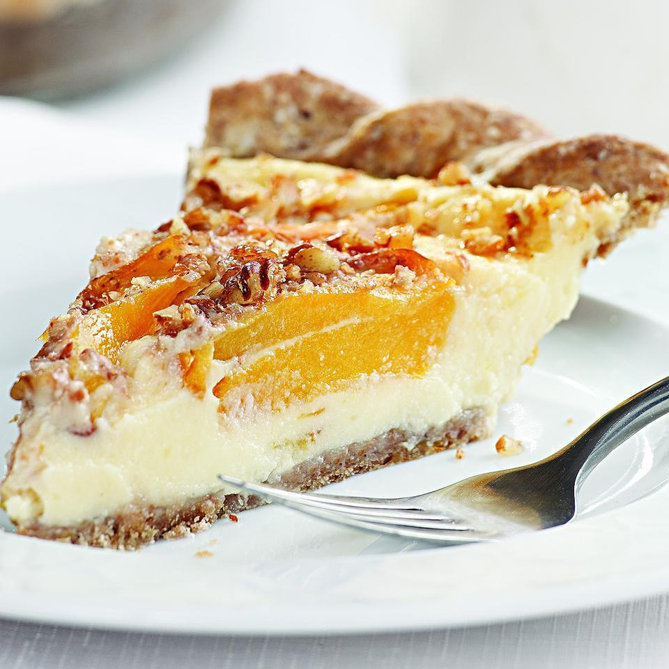 We use low-fat milk along with nonfat Greek yogurt in the creamy custard for this peach pie. The yogurt gives the custard a smooth texture without using cream or too many egg yolks. A slice is just as delicious served warm from the oven as it is chilled. For an added treat, serve topped with fresh blueberries.