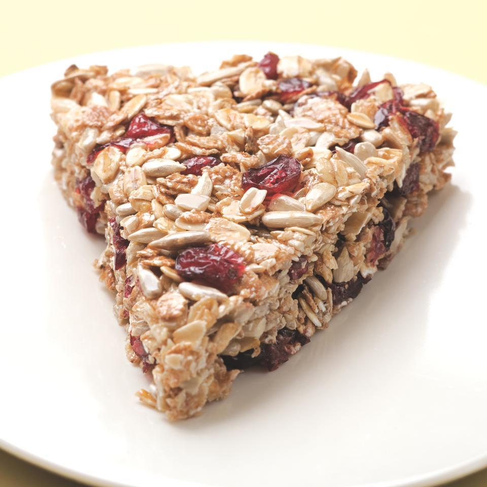 This recipe was inspired by chef Lars Kronmark's granola wedges from the Culinary Institute of America at Greystone. Substitute your favorite fruit, nuts and/or seeds for the sunflower seeds and/or dried cranberries in these granola bars. Source: EatingWell Magazine, September/October 2010