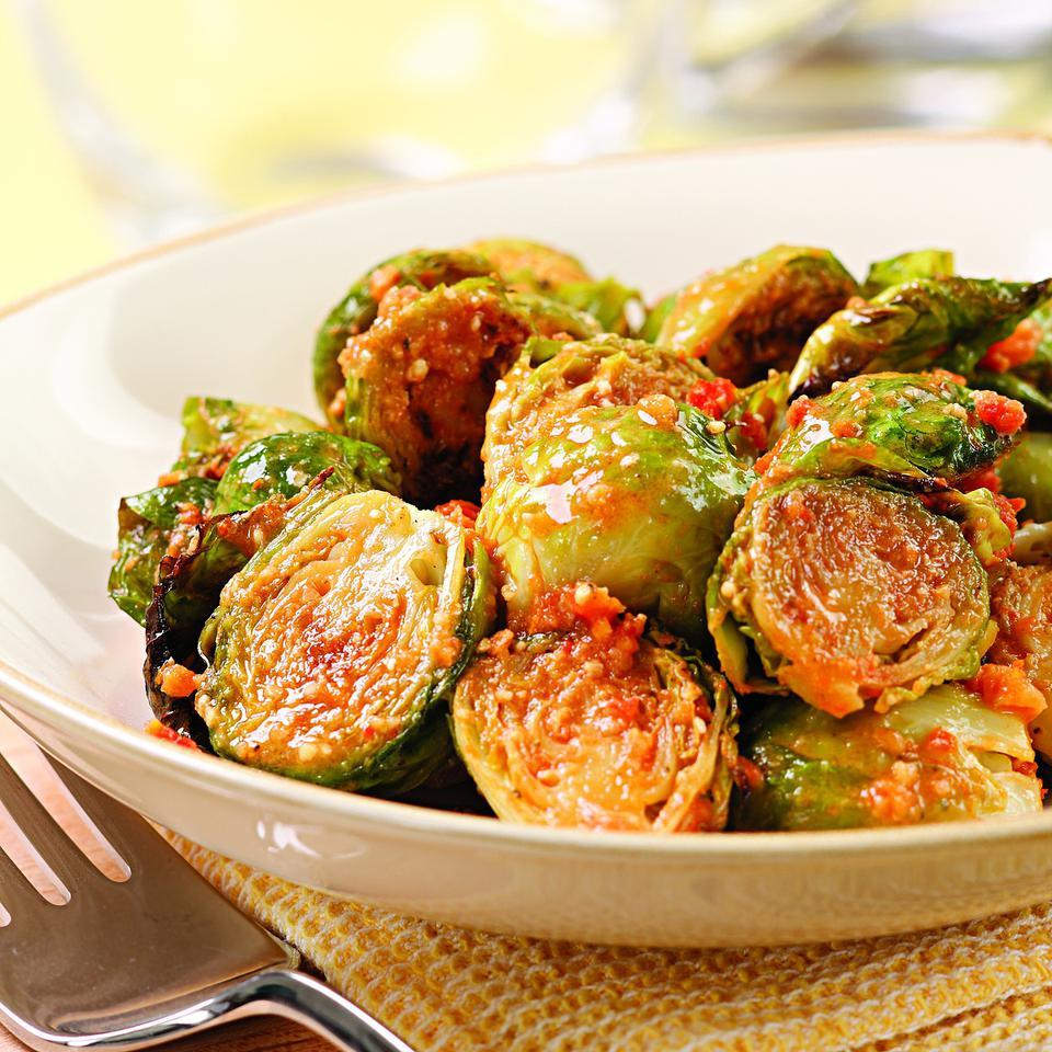 This recipe adds an unexpected brightness to the Thanksgiving table. First, the sprouts are roasted with a little bit of olive oil. For the pesto, all that's involved is a little bit of pulsing sundried tomatoes, oil, pine nuts, oregano and vinegar in the food processor before stirring in the Parmesan cheese. The nutty roasted sprouts are then tossed with the semi-sweet pesto for an uncommonly good side dish.