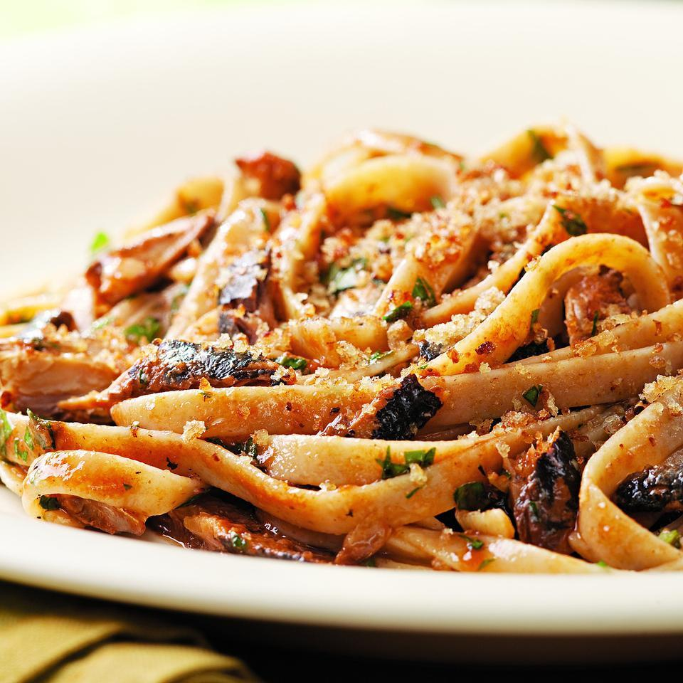 Even sardine skeptics will enjoy this lemony pasta with crispy breadcrumbs. Substitute a 5- to 6-ounce can chunk light tuna for the sardines if you prefer. If you are using tuna or can't find sardines packed in tomato sauce, add 1 tablespoon tomato paste with the lemon juice in Step 4. Serve with a salad of bitter greens tossed with a lemon vinaigrette and a glass of pinot grigio. Source: EatingWell Magazine, November/December 2010