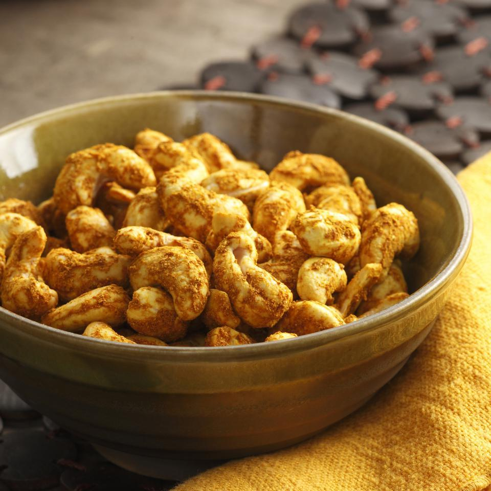 These curried cashews are impossibly addictive--every time we made them in the Test Kitchen they disappeared in a flash. If you use salted cashews, omit the added salt.
