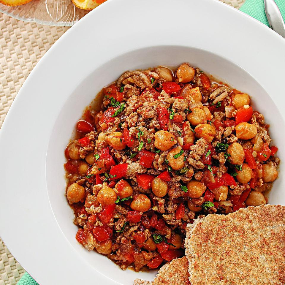 This spicy chili for two has a North African spin with lamb, cinnamon and harissa. If you can't find harissa, use mild chili powder in its place. You can turn up the heat with a little cayenne or hot sauce if you like it spicy. Serve with whole-wheat pita bread and tabbouleh.