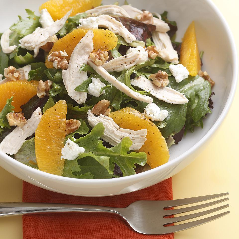 Orange segments, toasted walnuts and tangy goat cheese brighten up this simple salad. Try this salad for a take-along lunch. To keep the salad greens from getting soggy, pack the greens, salad toppings and dressing in separate containers and toss them together just before eating.
