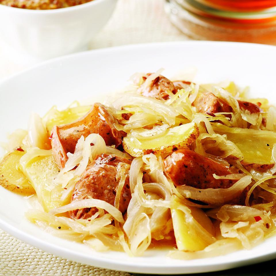 "Here's our weeknight version of choucroute garni, ""dressed sauerkraut,"" made with chicken sausage. The flavor of the dish will vary depending on what type of chicken sausage you choose. We like the taste of roasted garlic sausage or sweet apple sausage in this recipe. And although any type of sauerkraut can be used, we prefer the crisp texture of refrigerated kraut over canned. The recipe serves two. Serve with roasted carrots and some mustard to spread on the sausage."