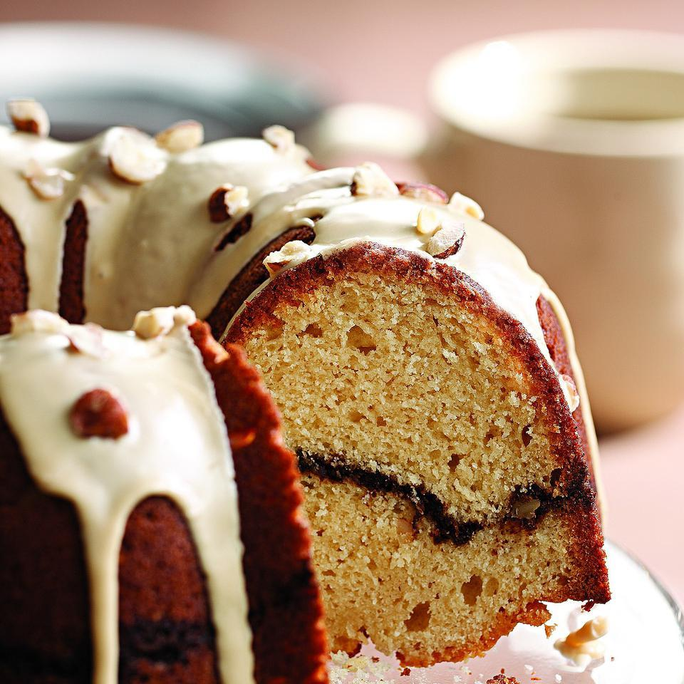 Can you really have too much of a good thing when it comes to the combination of coffee and cake? Here, we've created a lighter but still moist and rich Bundt cake, added a ribbon of hazelnut-coffee streusel inside and a drizzle of coffee glaze on top. To say it tastes great with a good cup of coffee is an understatement. Recipe by Joyce Hendley for EatingWell.