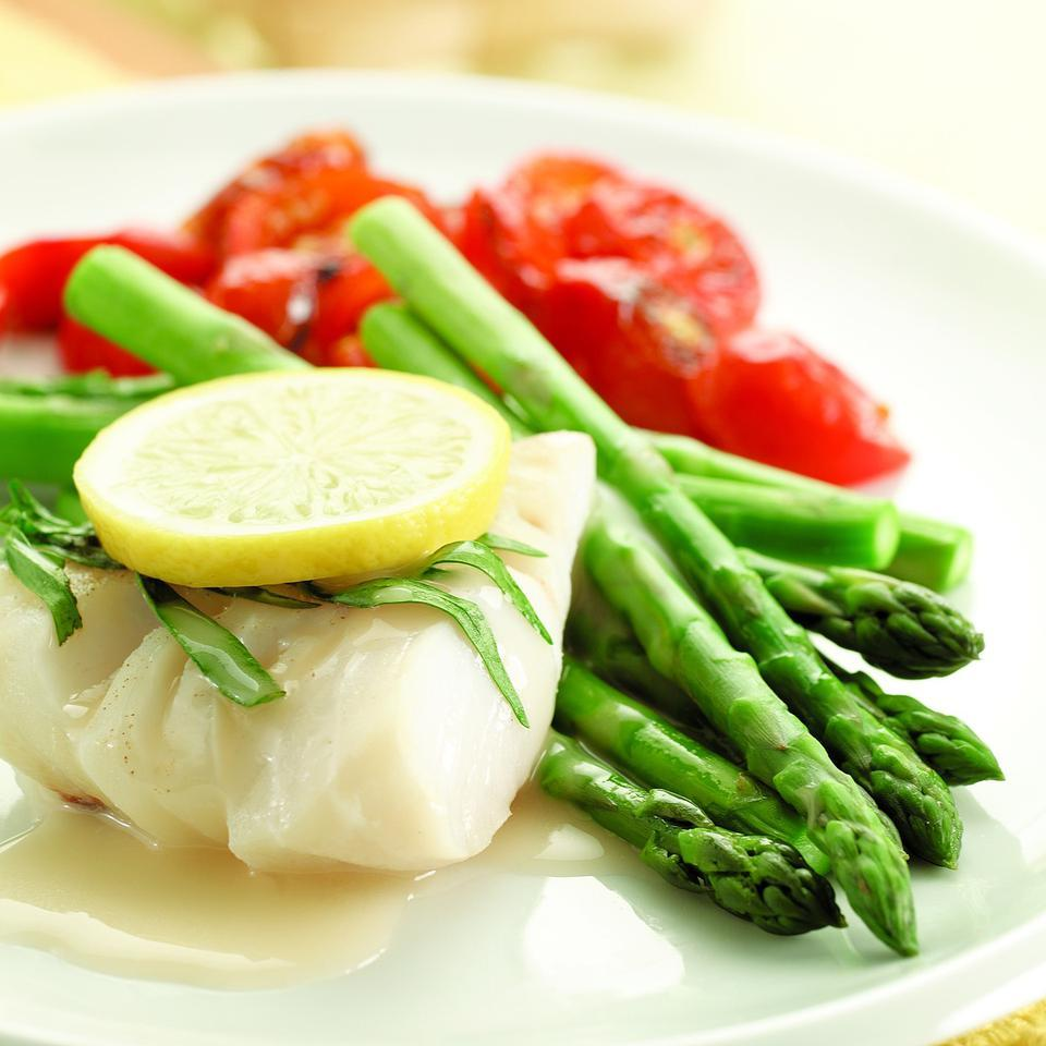 In this recipe, we poach the cod right on top of the asparagus. The result is perfectly cooked cod and tender-crisp asparagus. The sauce is our take on beurre blanc--a traditional French sauce made with wine and lots of butter. Ours uses a little cornstarch for thickening and a judicious amount of butter for flavor.