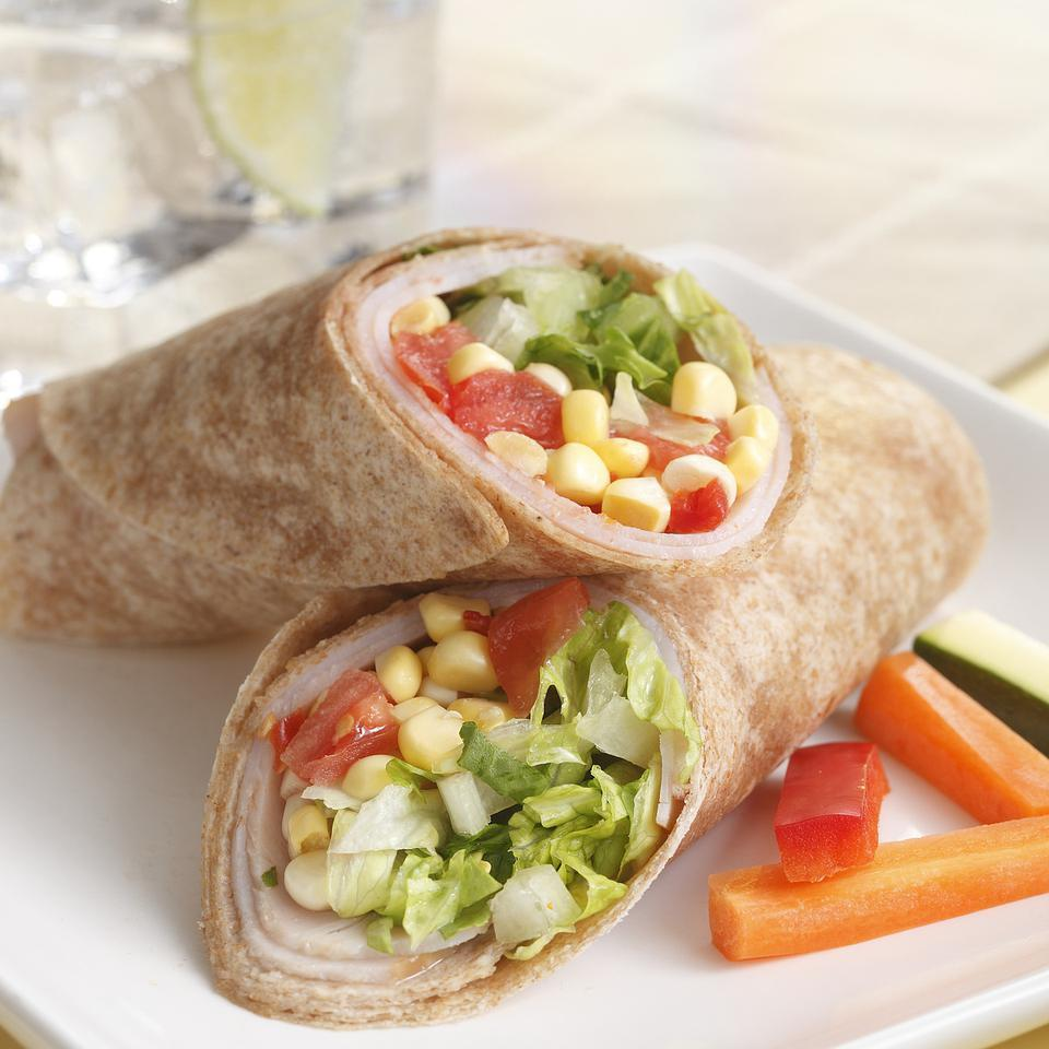 Fresh corn kernels, tomatoes and lettuce fill these hearty turkey wraps. This wrap is great for picnics or when you need to have dinner on the run. Add some crumbled feta or shredded Cheddar for another layer of flavor. Serve with carrot sticks, sliced bell pepper or other crunchy vegetables plus your favorite creamy dressing. Source: EatingWell Magazine, July/August 2011