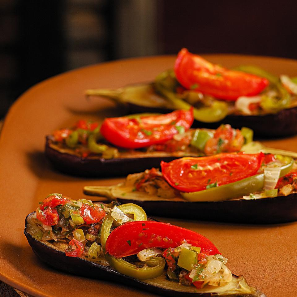 These stuffed eggplants are filled with peppers, onion, garlic and tomatoes. Serve it along with olives, hummus, warm pita and tabbouleh for a fantastic vegetarian feast. Source: EatingWell Magazine, September/October 2011