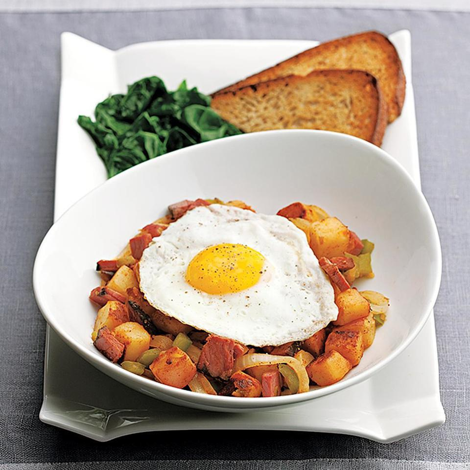When we're in a hurry, we love to have breakfast for dinner. Precooked diced potatoes--available in the refrigerated section of most supermarkets--help make this pastrami hash ultra-fast. (If you have leftover cooked potatoes, use about 3 cups diced cooked potatoes instead.) Serve with rye toast and sautéed spinach.