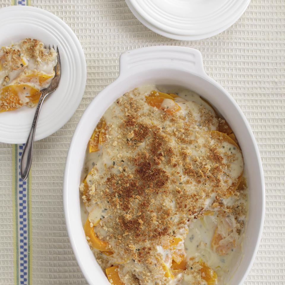 Roasted butternut squash slices layered with a creamy sauce and topped with golden breadcrumbs makes a hassle-free side dish that just about everyone loves. Our healthier version skips the heavy cream and butter found in most recipes--saving about 160 calories and 12 grams of saturated fat compared to a traditional version.