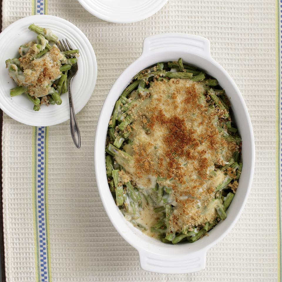 Typical green bean casseroles bathe ingredients in a heavy cream sauce and top them with buttered breadcrumbs or cheese. Our healthier version saves about 160 calories and 12 grams of saturated fat compared to a traditional recipe.