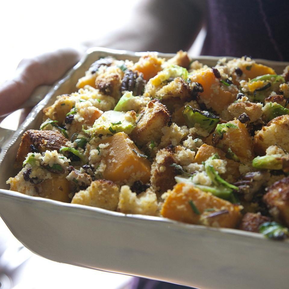 Brussels sprouts and winter squash make this cornbread stuffing look and taste great. You may need to bake two batches of cornbread to have 2 pounds for this recipe--you can even make it the day before.