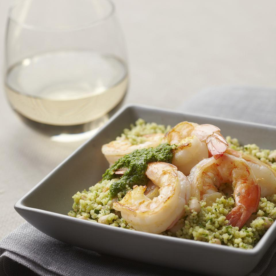 This quick dinner recipe of couscous, white beans and shrimp is flavored with a potent parsley-and-basil dressing.