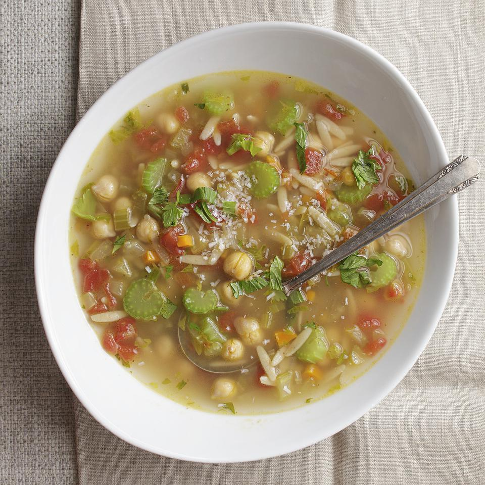 This simple healthy minestrone soup recipe cooks in less than 30 minutes and uses celery stalks, leaves and dried celery seed to flavor the delicious Parmesan-laced tomato broth.