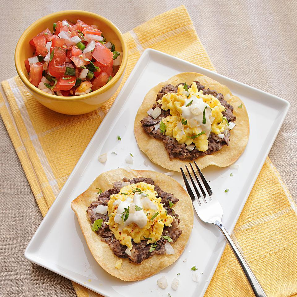 If you love breakfast burritos or huevos rancheros, you'll love this tostada with seasoned black beans on crispy tortillas with scrambled eggs on top. Pass salsa or hot sauce to go with it. Source: EatingWell Magazine, March/April 2012