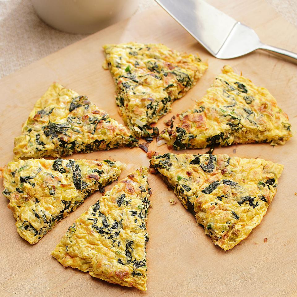 This frittata is packed with hearty greens and leeks with a touch of salty bacon or pancetta and Asiago cheese for flavoring. We tested the recipe both with egg substitute and whole eggs. It works great either way, but has fewer calories and less saturated fat when you use egg substitute. Source: EatingWell Magazine, March/April 2012
