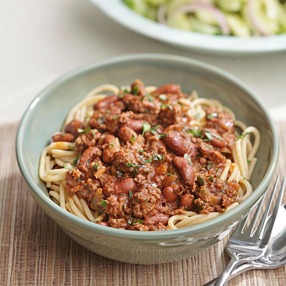 Cincinnati has a unique spin on chili--they serve it over spaghetti. Typically the chili is just made with meat, no beans, but we couldn't resist adding beans to add fiber and nutrients. Serve with sliced cucumber and red onion with lemon juice and olive oil.