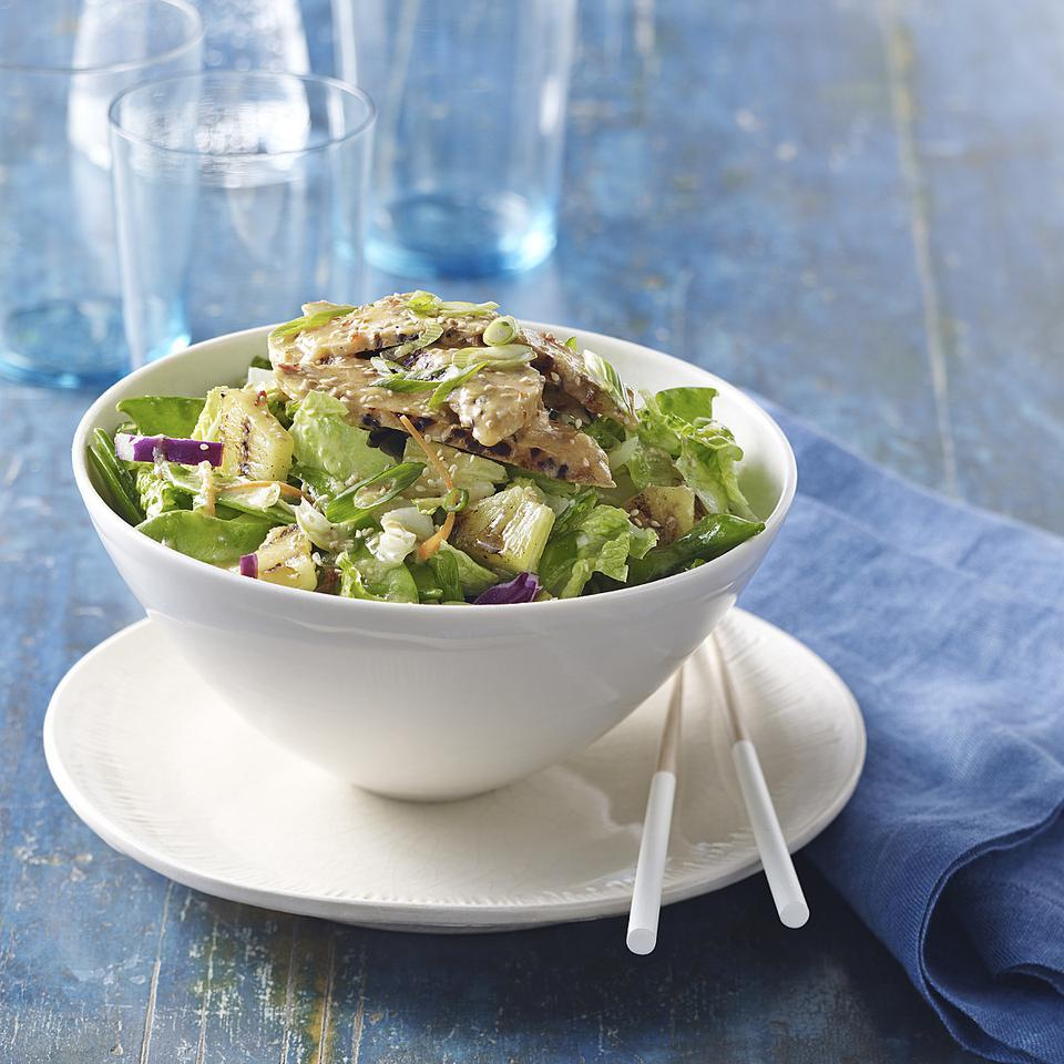 This bold sesame-ginger dressing recipe is perfect with this salad of grilled tempeh, pineapple and crisp snow peas. If you can't find mixed Asian greens, try another spicy green, such as arugula.Source: EatingWell Magazine, May/June 2012