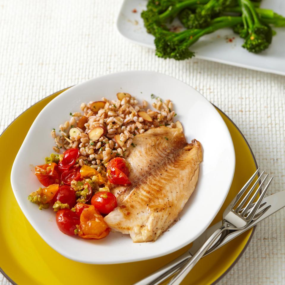 Top tilapia fillets with a savory tomato-olive sauce that comes together in just 5 minutes. Look for tapenade near jarred olives in the supermarket. Serve with sautéed broccolini and farro tossed with toasted almonds.