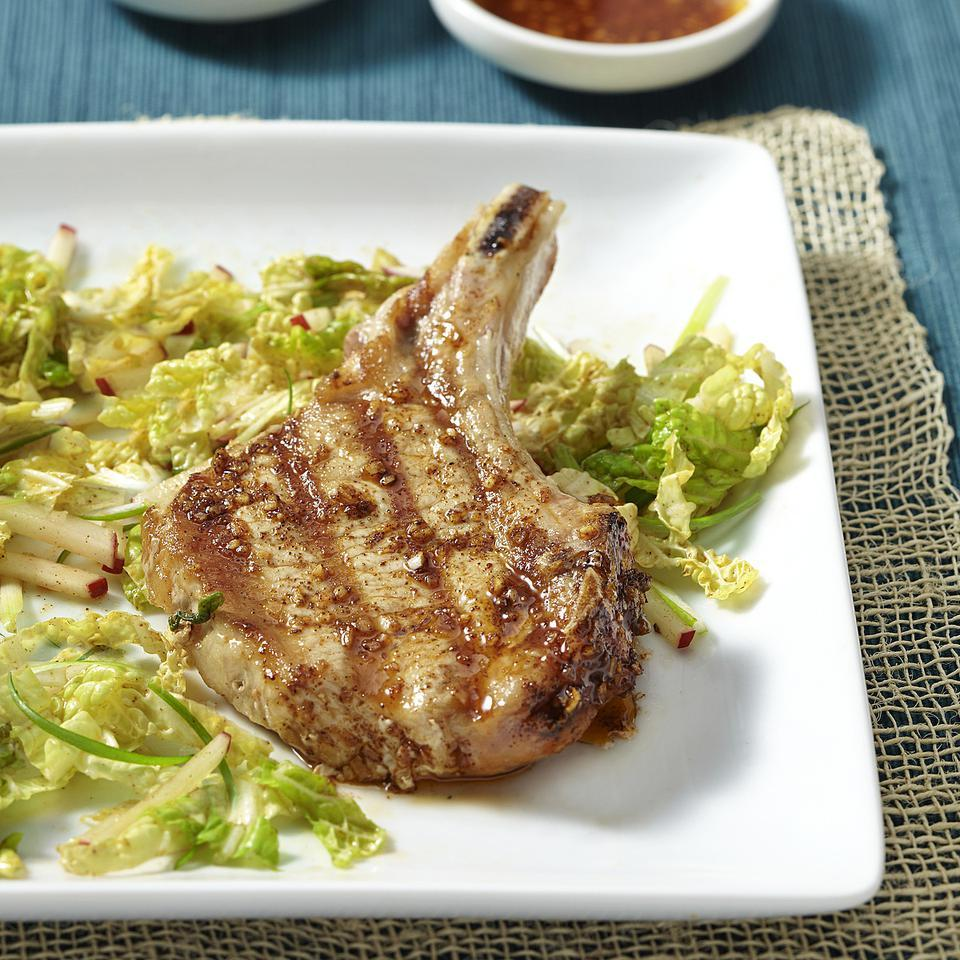 Chili powder and garlic, both of which star in Korean cuisine, season grilled pork chops and a cool, tangy slaw. If you can find Korean chili powder use it, otherwise conventional chili powder is fine.
