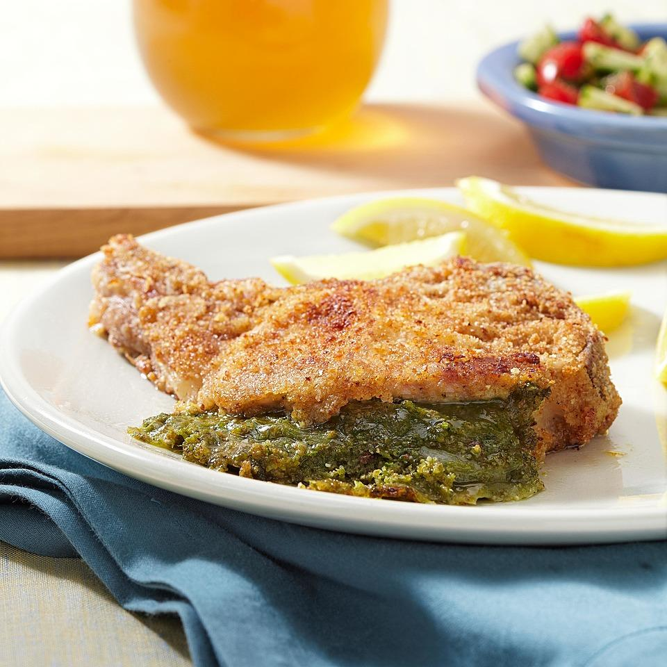 Pesto gives great flavor to the oozy mozzarella stuffing in this breaded pork chops recipe. Source: EatingWell Magazine, May/June 2012