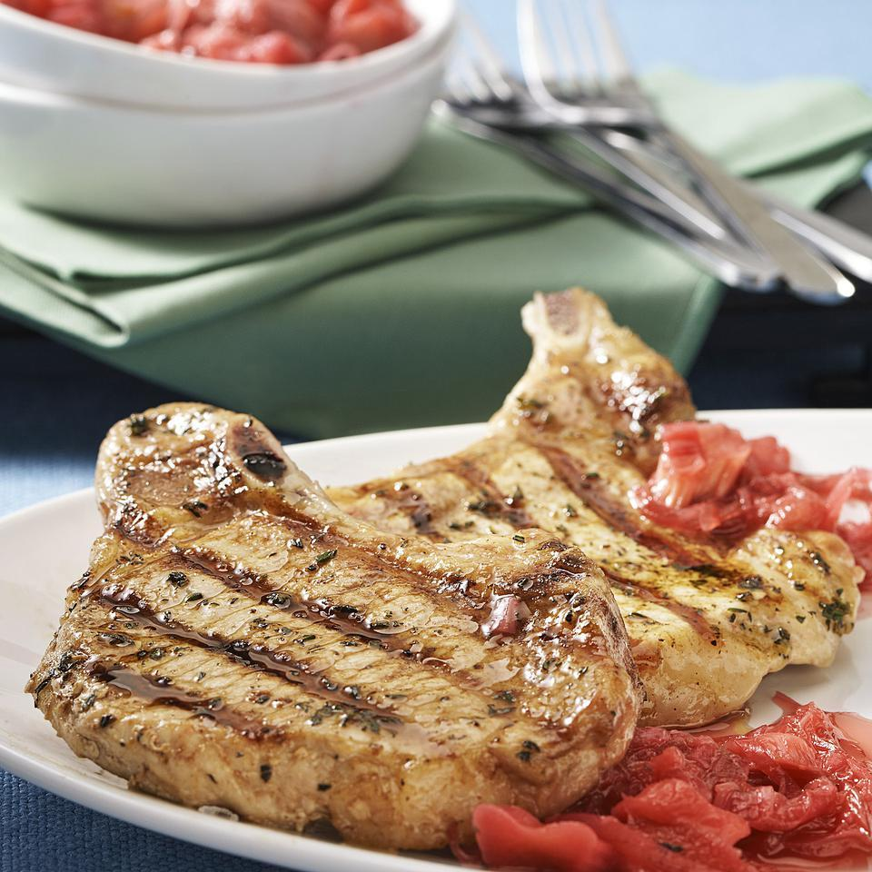 This grilled pork chop recipe features a savory rhubarb sauce that can cook in the microwave while you grill the pork chops.