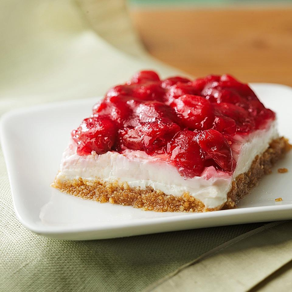 This no-bake cherry cheesecake is an easy summertime treat. This no-bake cheesecake recipe has omega-3-rich walnuts in the graham cracker crust and uses nonfat Greek yogurt and reduced-fat cream cheese in the filling to keep saturated fat in check. If you want a bright red topping, use sour cherries. Sweet cherries give it a more purple hue. To make gluten-free no-bake cherry cheesecake, use gluten-free graham crackers.