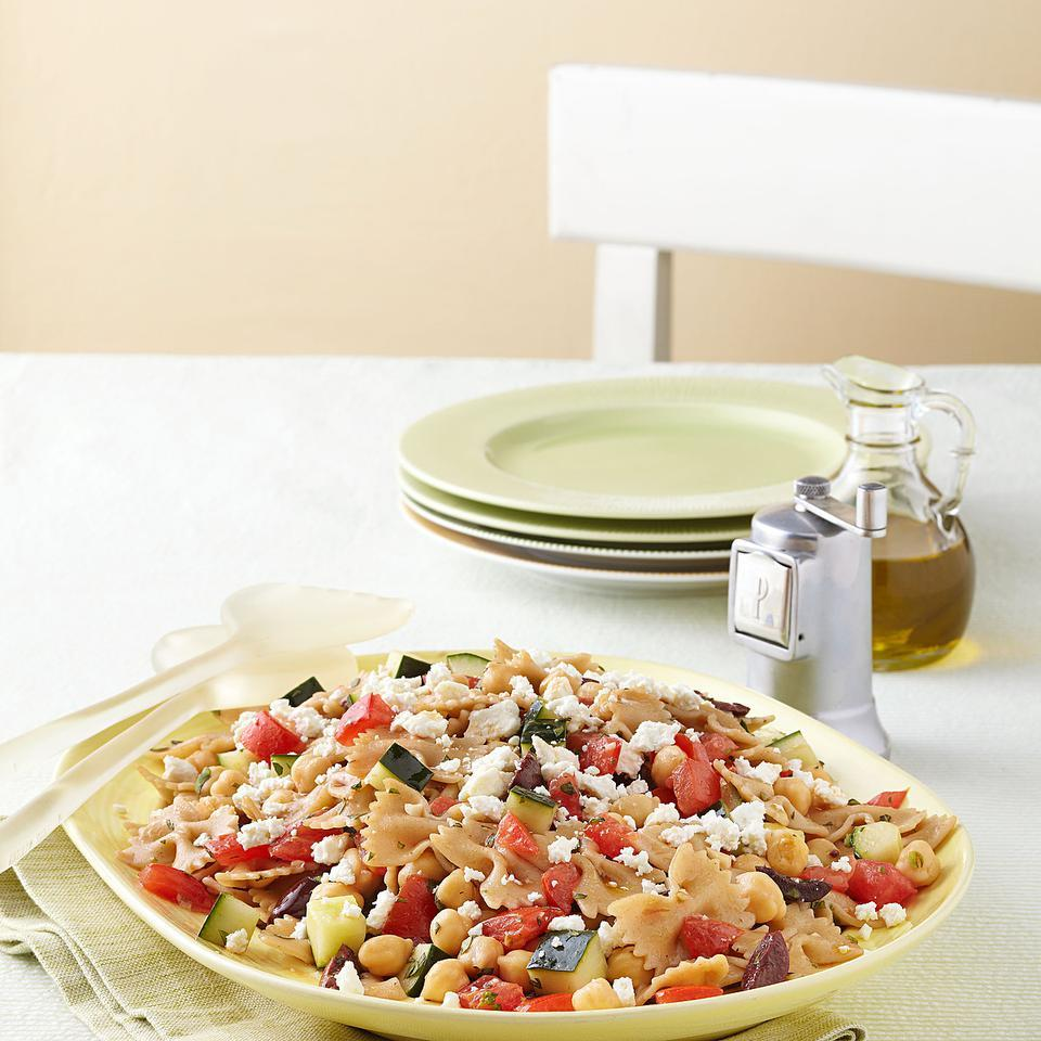 This quick, healthy Greek pasta salad recipe is tossed with all the elements of a Greek salad--plus chickpeas for added protein. This pasta salad holds well in the refrigerator or a cooler and tastes even better as the pasta absorbs the tomato-infused vinaigrette. Serve with pita chips.