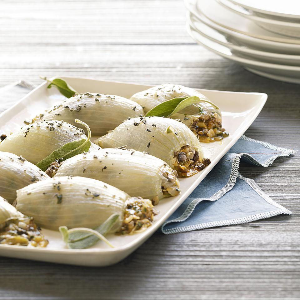 In this recipe for stuffed onions, mild onion layers are filled with a tasty mushroom and Cheddar cheese blend spiked with sage and a splash of dry sherry. Serve as a vegetarian main dish for 4 or as a vegetable side dish for 8.