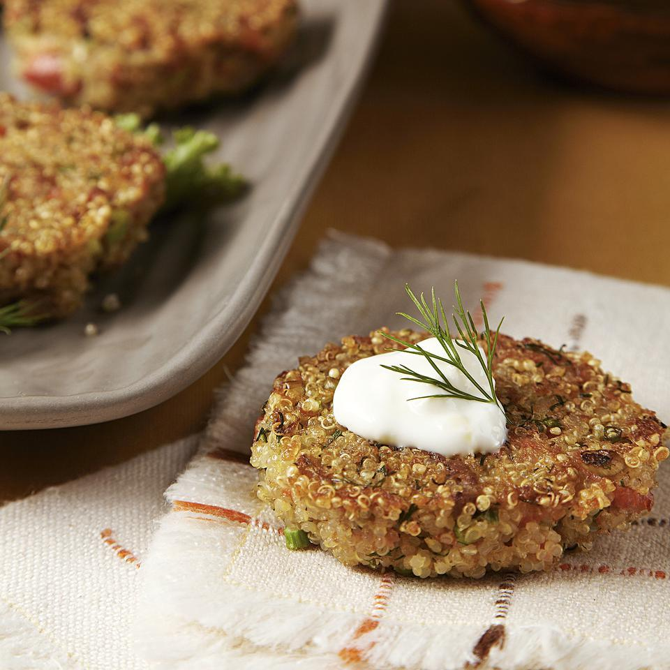 These crisp quinoa cakes spiked with smoked salmon and topped with lemony sour cream make a lovely appetizer.Source: EatingWell Magazine, November/December 2012